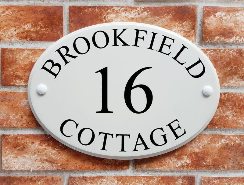 Oval house plaque in white