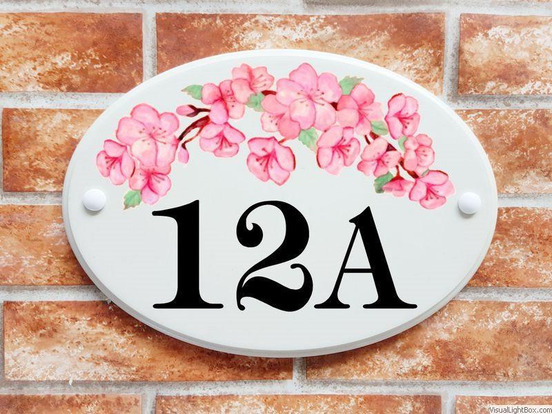 Large house number plaque with blossom