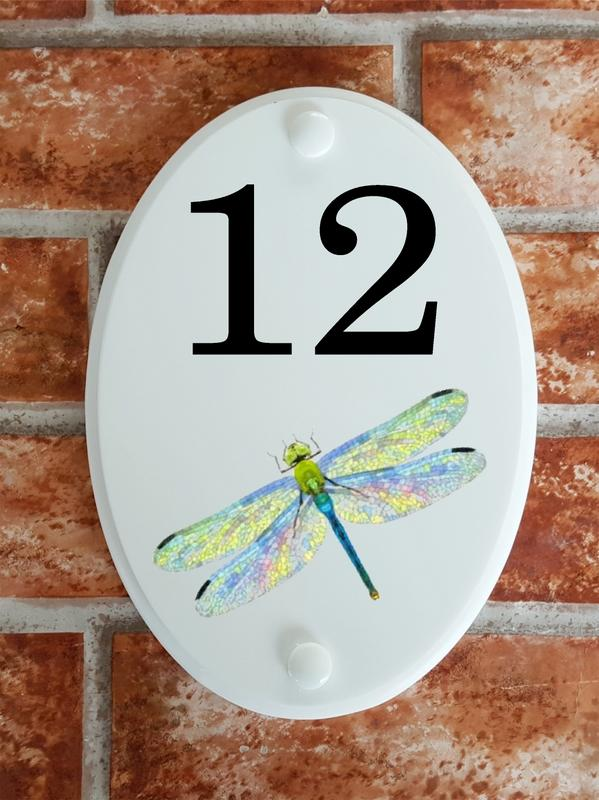 House number sign displaying a dragonfly