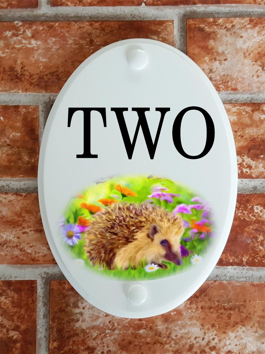 House number plaque with hedgehog picture motif