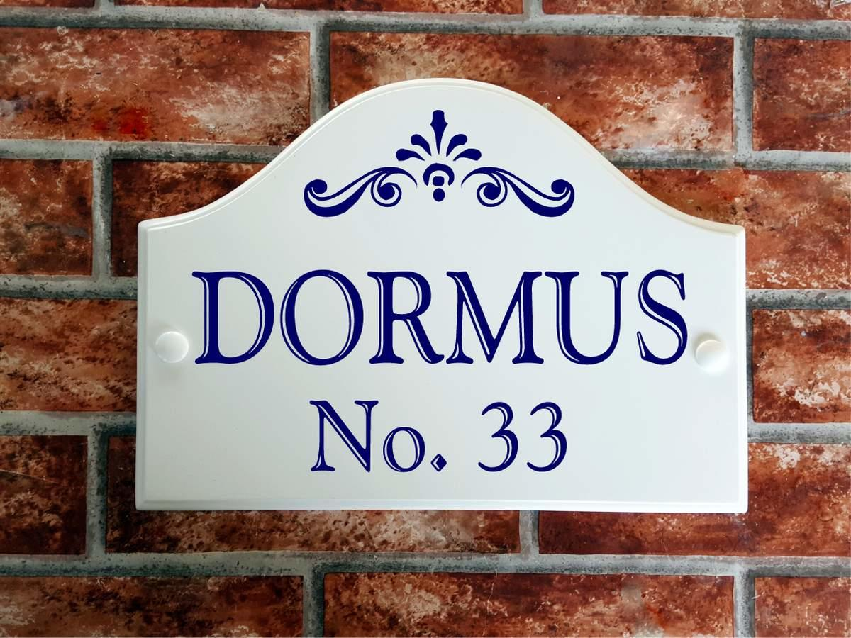 bridge style house plaque with blue text