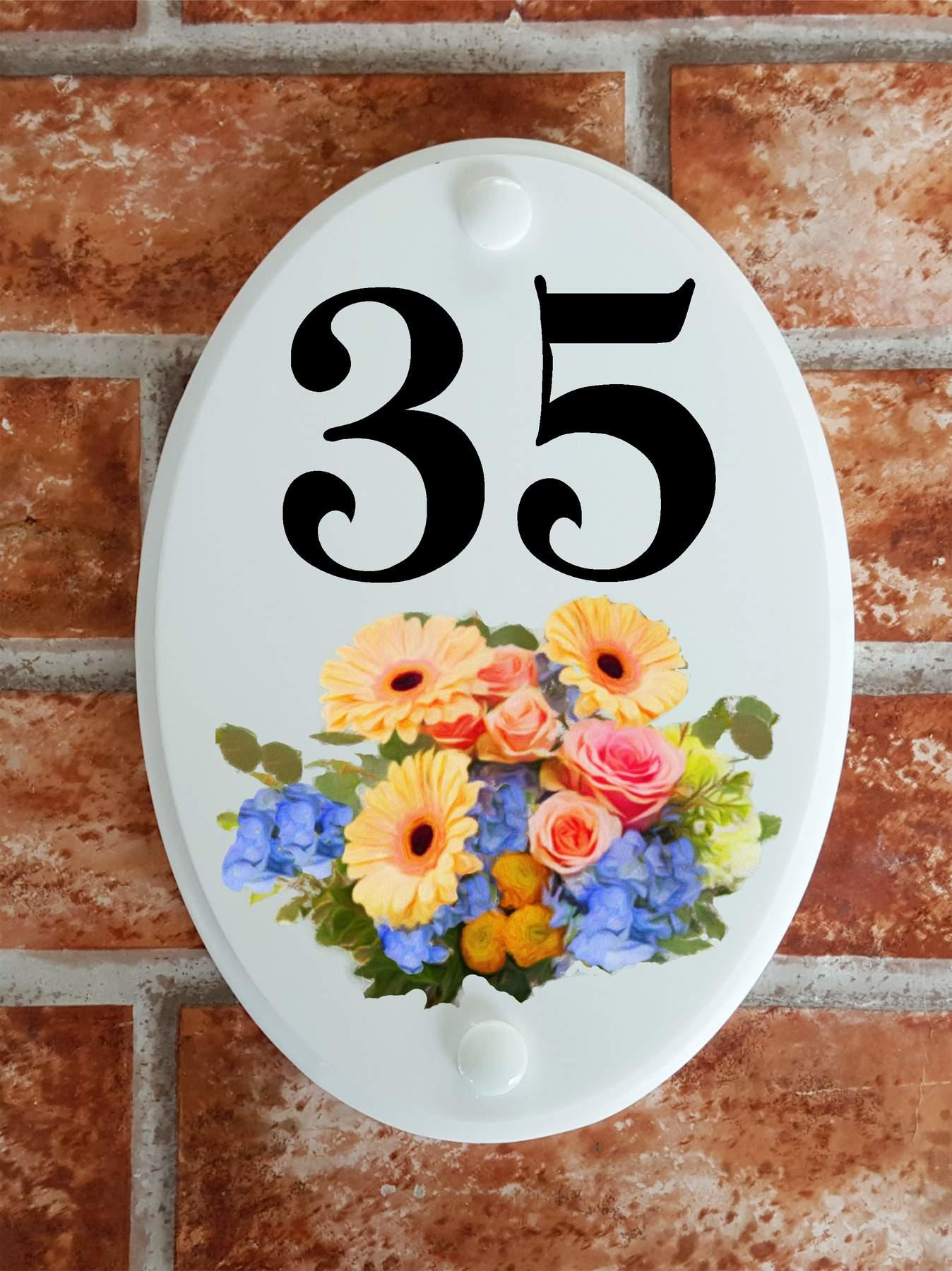 colourful flower arangement on a house number sign