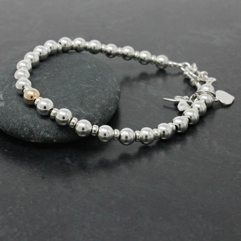 silver bracelet with gold bead