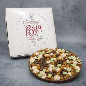 Milk chocolate pizza with chocolate 'olives', 'cheese' and 'salami