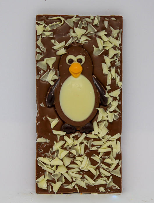 34% milk chocolate with a chocolate penguin and curls