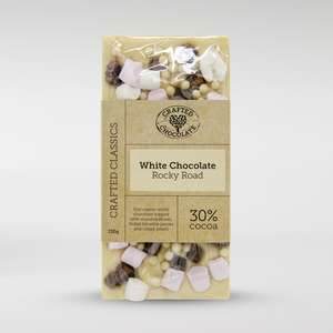 28% cocoa white chocolate bar with mini mallows, fudge brownie pieces and cocoa nibs