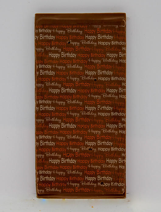 34% milk chocolate bar with a birthday balloon design