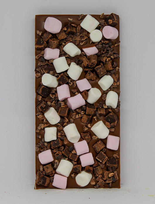 34% milk chocolate with mini mallows, fudge brownie pieces and cocoa nibs in birthday packaging