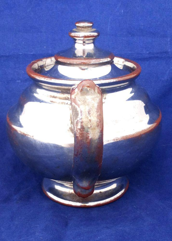 Victorian antique platinum lustre teapot with a shouldered round body on a pedestal foot and with a low collar, it is bachelor sized circa 1840