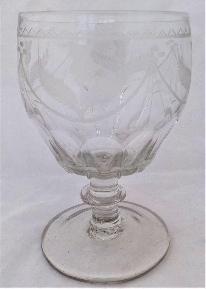 Antique Georgian petal moulded glass rummer engraved thistles and swags barrel bowl blade knop stem and plain conical foot circa 1800.