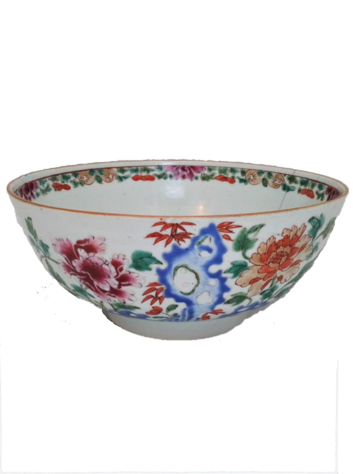 A beautiful antique Qing dynasty 清代 18th Century Kangxi 康熙 era Chinese Porcelain Bowl decorated in hand painted enamels in the Famille Rose palette with a hollow blue rock, peonies, bamboo and Lingzhi fungus, circa 1710.