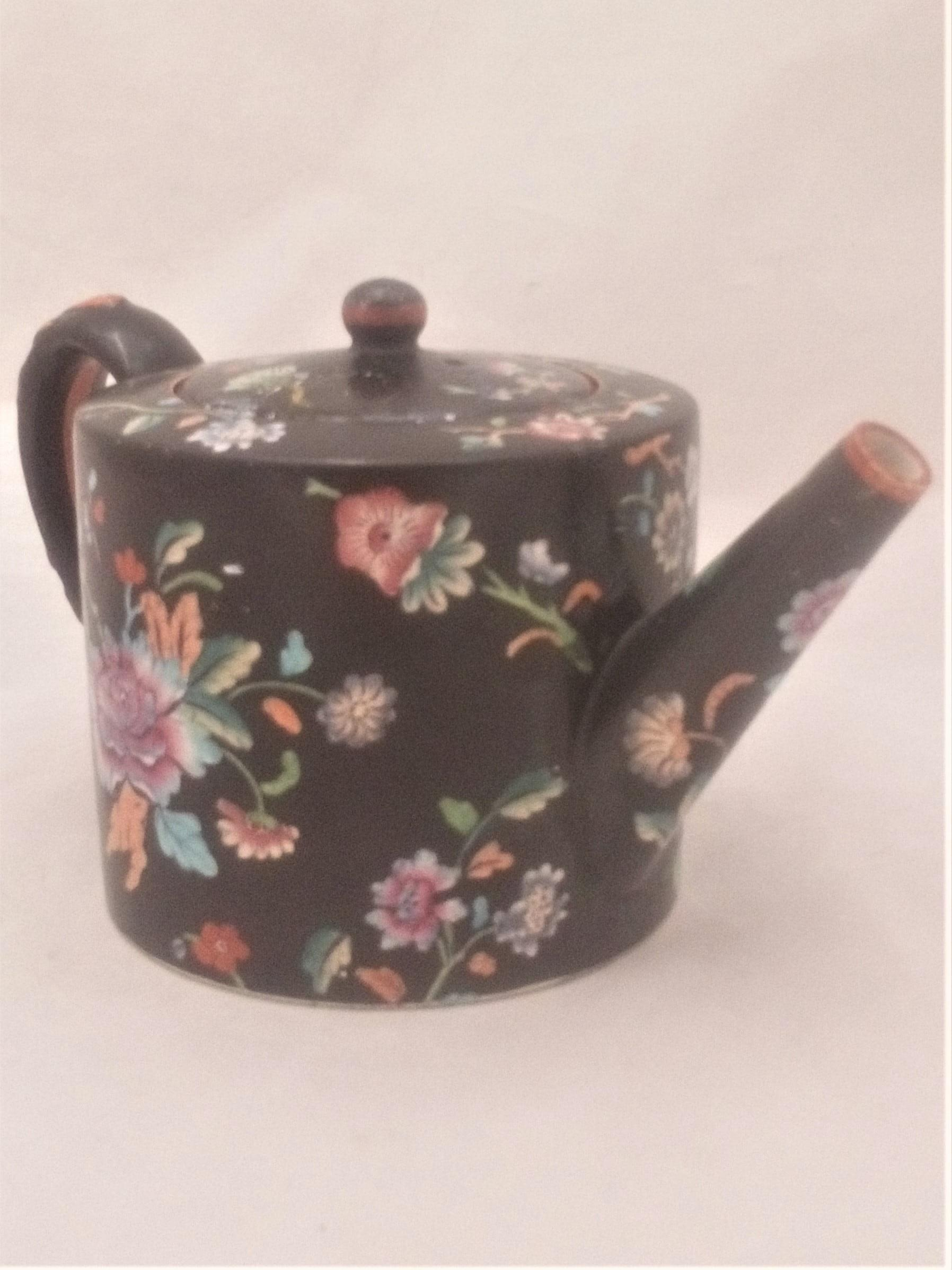 Antique Davenport transferware cylindrical teapot  decorated with the Chrysanthemum Floral Spray pattern on a black ground circa 1860