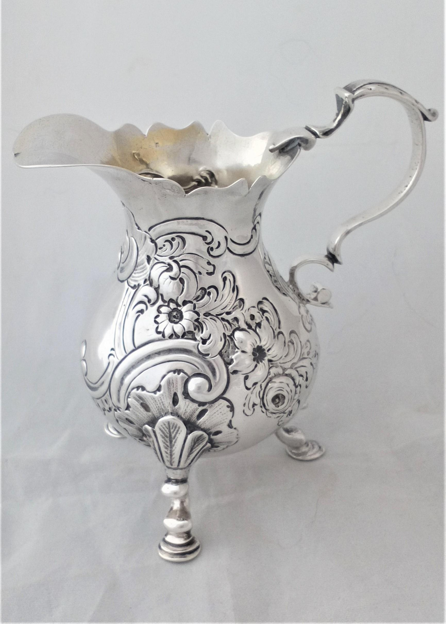 Antique George II Silver Cream Jug Pear Shaped with chased and repousse decoration Hallmarked Sterling silver London 1753 Louis Hamon 101 grammes
