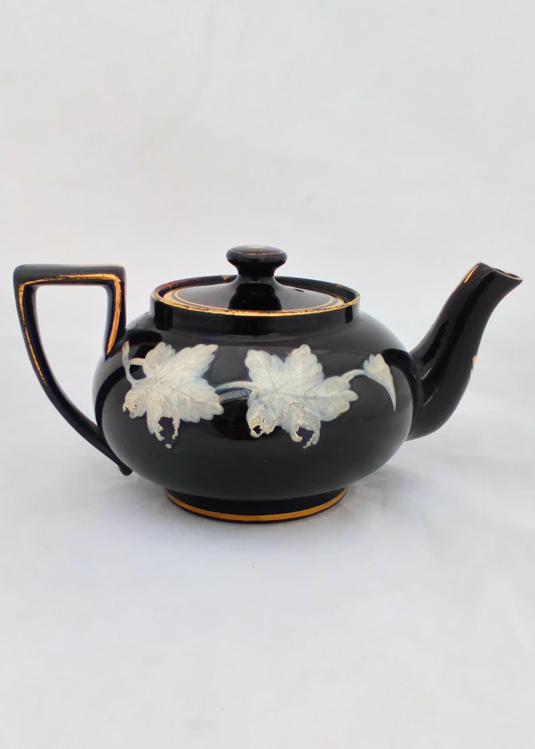 Victorian black glazed teapot with white enamelled vine leaves and stems antique circa 1850