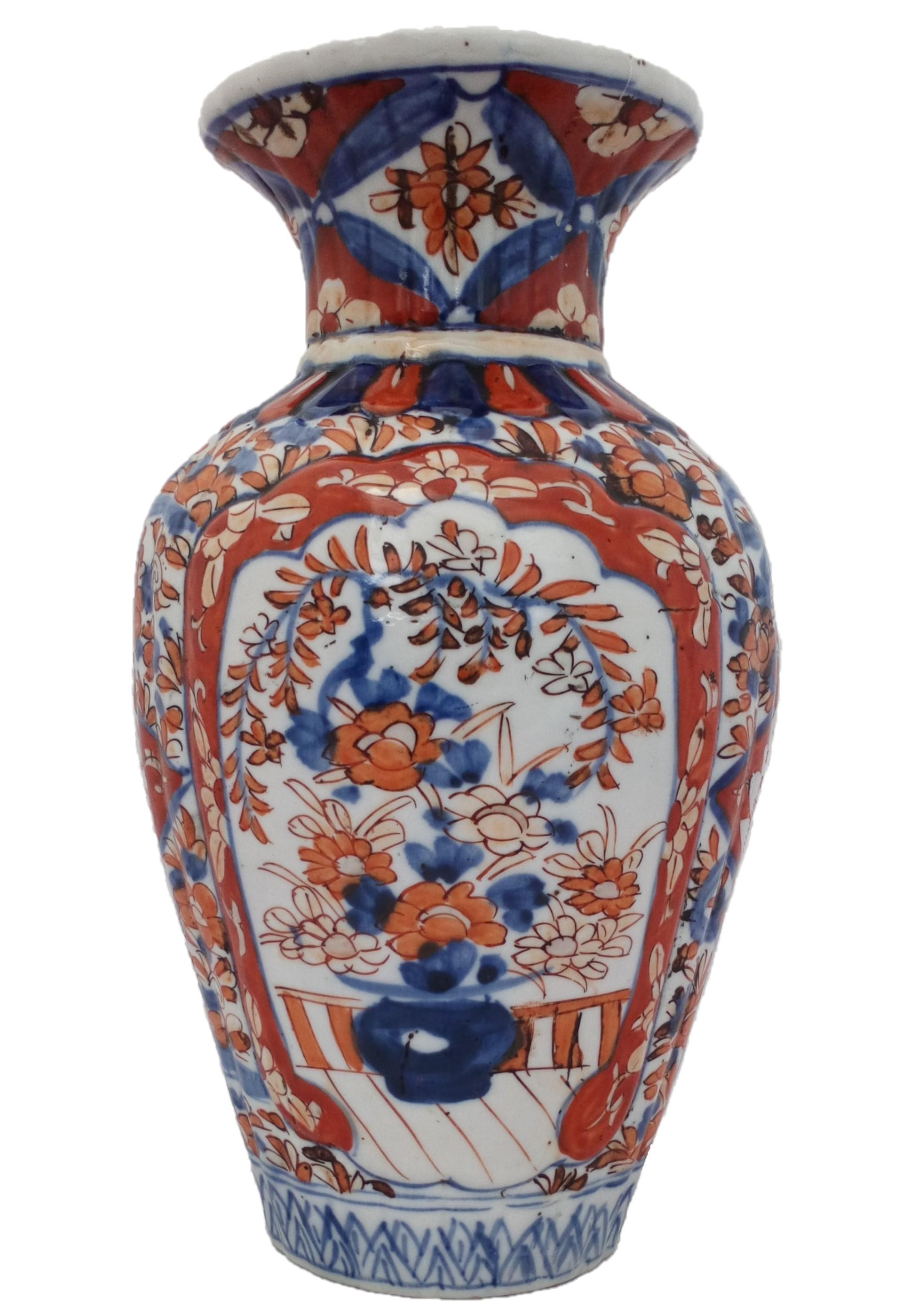 An antique Japanese Imari porcelain vase with a ribbed body hand painted 19th Century Meiji period.