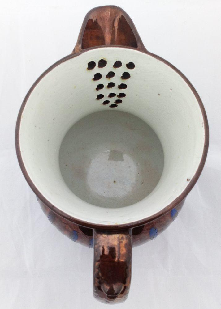 Antique Copper Lustre Strainer Jug with Low Relief Moulded Flowers Border c 1835