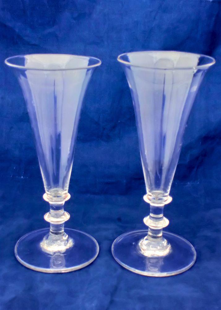 Pair antique Regency period dwarf ale glasses with plain drawn trumpet bowl and twin blade knop stem plain foot with a rough pontil mark circa 1820