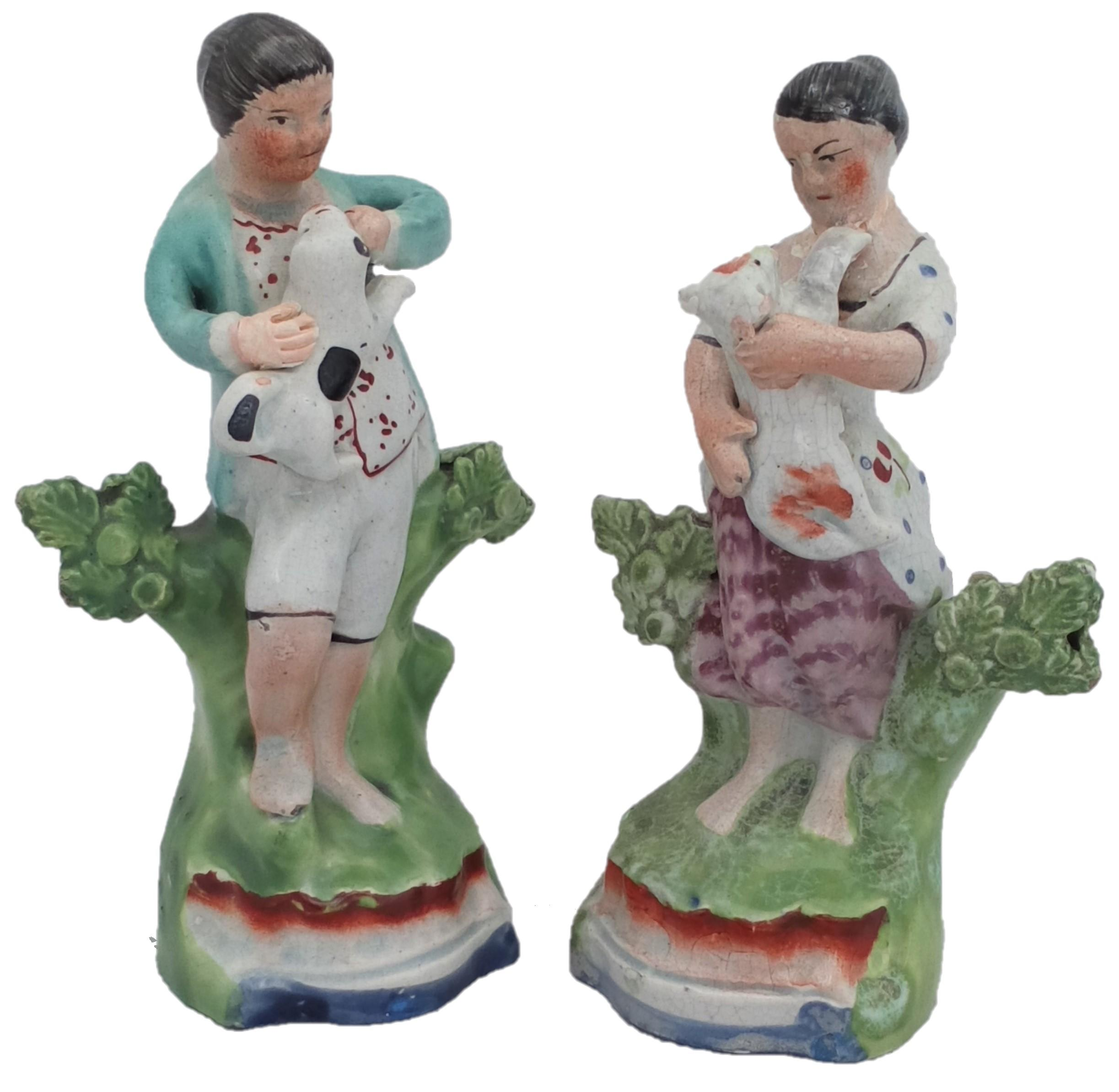 Antique Pair of Enamelled Pearlware Sherratt Style Bocage Figurines of Shepherd with Dog and Shepherdess with lamb circa 1820