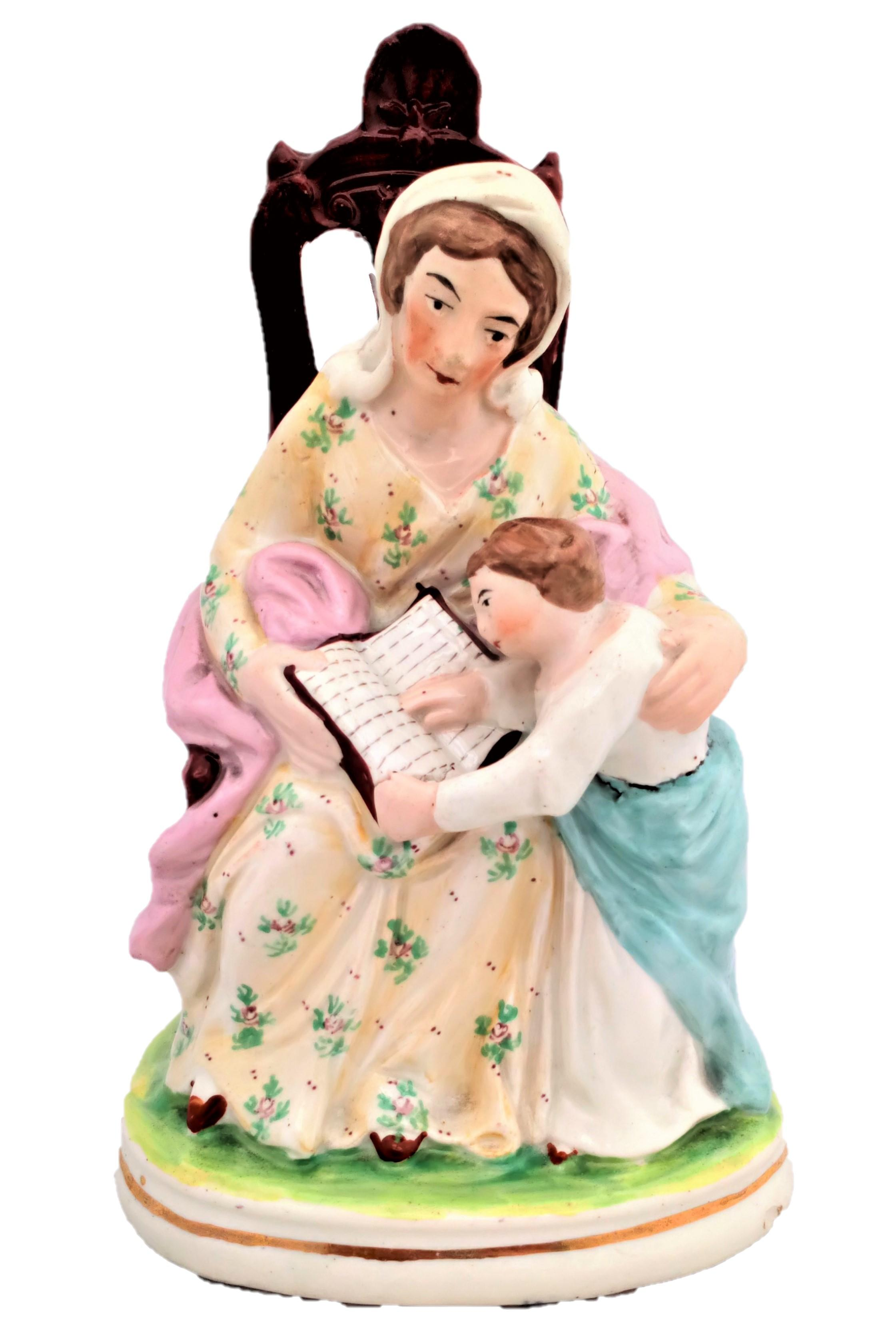 Antique Staffordshire Figurine The seated Prudent Mother and Child Reading circa 1850