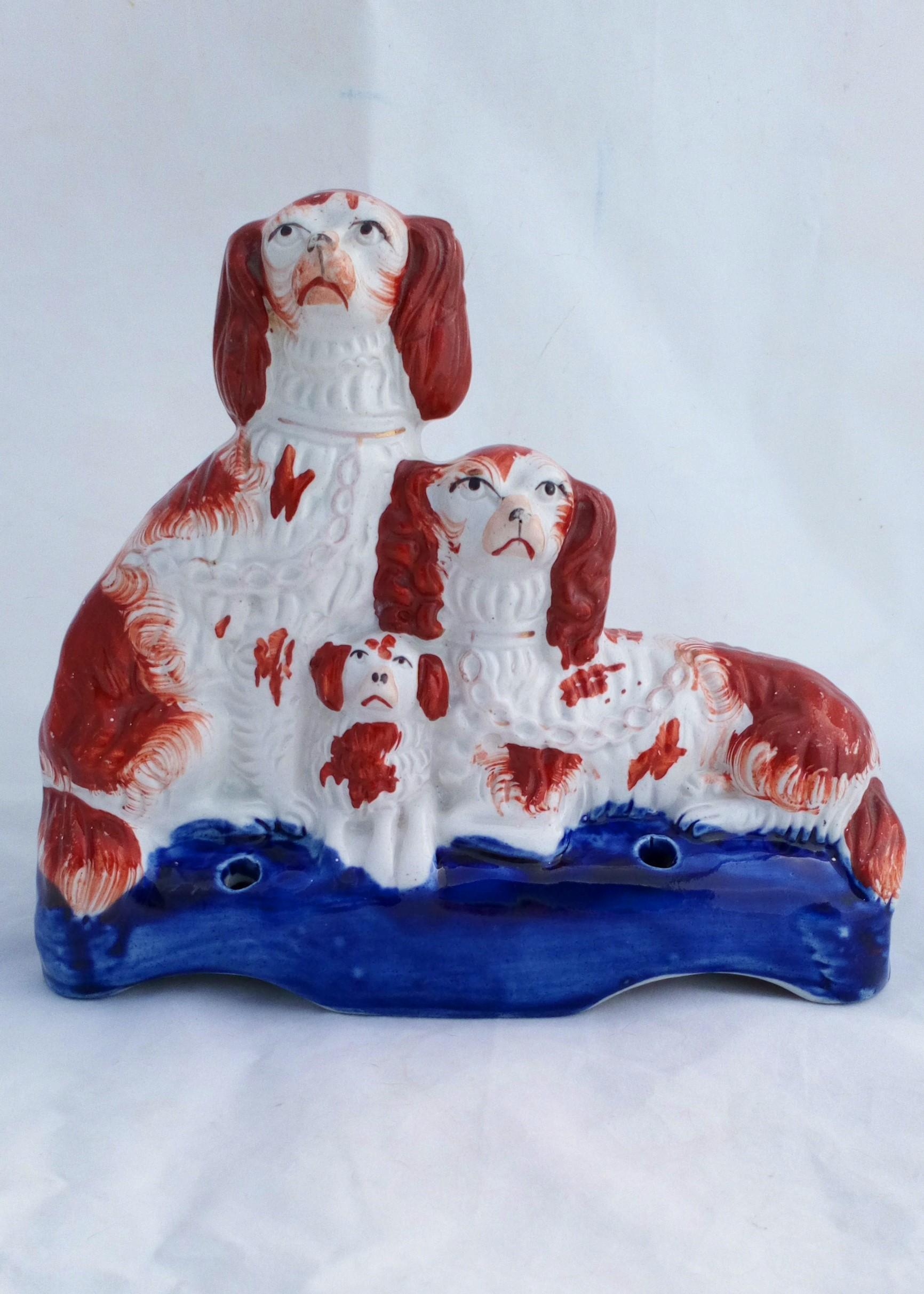 Antique Russet and white Staffordshire dog family group figurine quill holder circa 1860