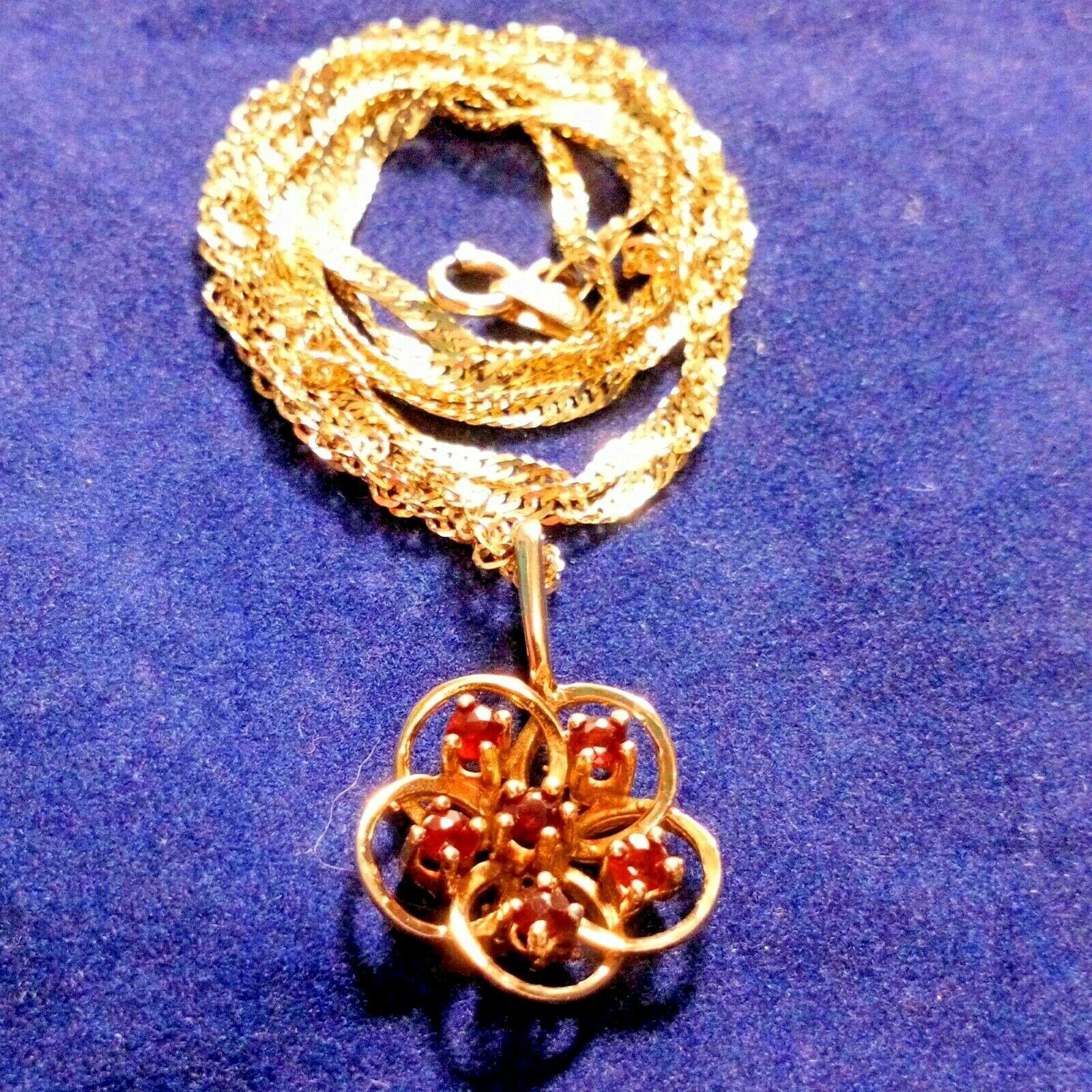 9ct Gold and Garnet Flower Shape Pendant with 24 in 9ct Gold Chain 3.5g HM 1979