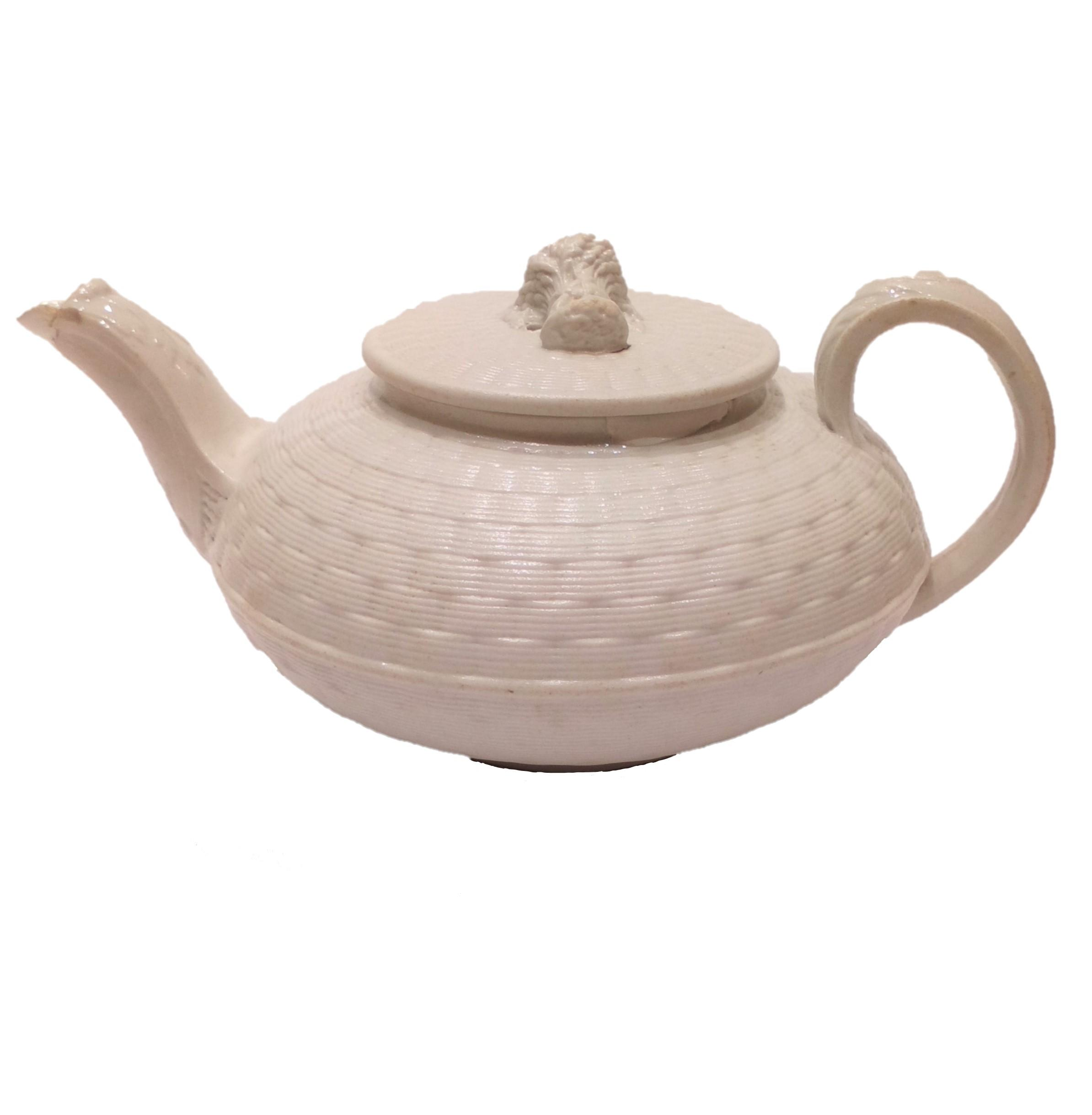 An antique Wedgwood white salt glazed stoneware teapot basket weave pattern with Wheat Sheaf finial circa 1825