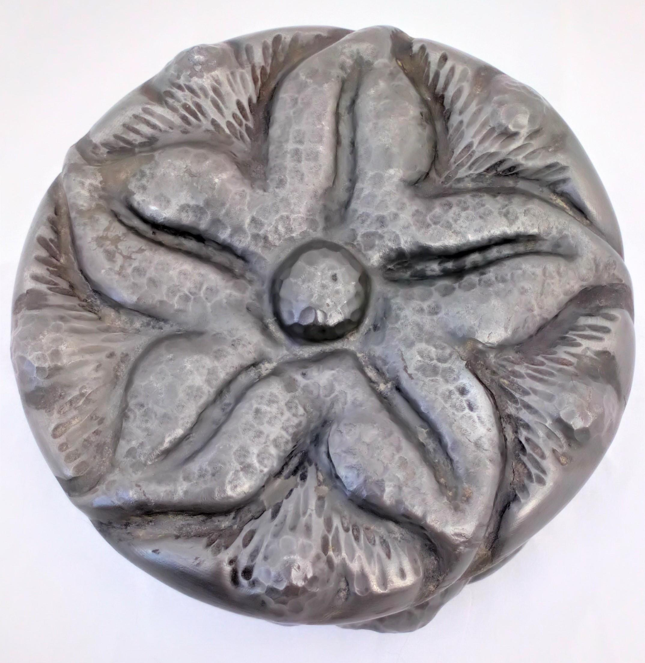 An antique French Art Nouveau Repousse Pewter Box with stylised five pointed flower by Alice & Eugene Louis Chanal circa 1910