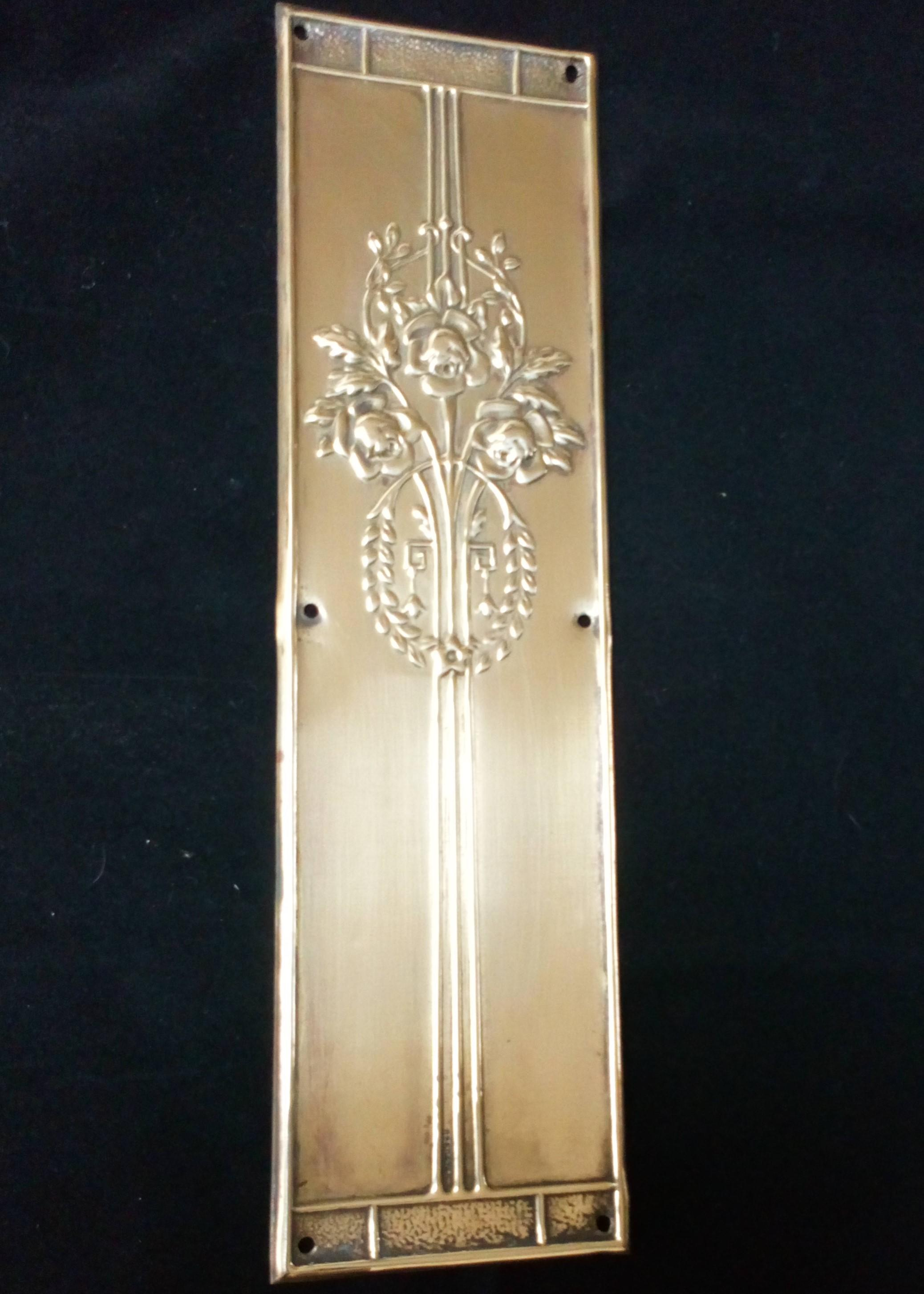 An antique Art Nouveau Pressed Brass finger plate for a door decorated with Glasgow Roses in original antique condition circa 1910 registered design number 604745.