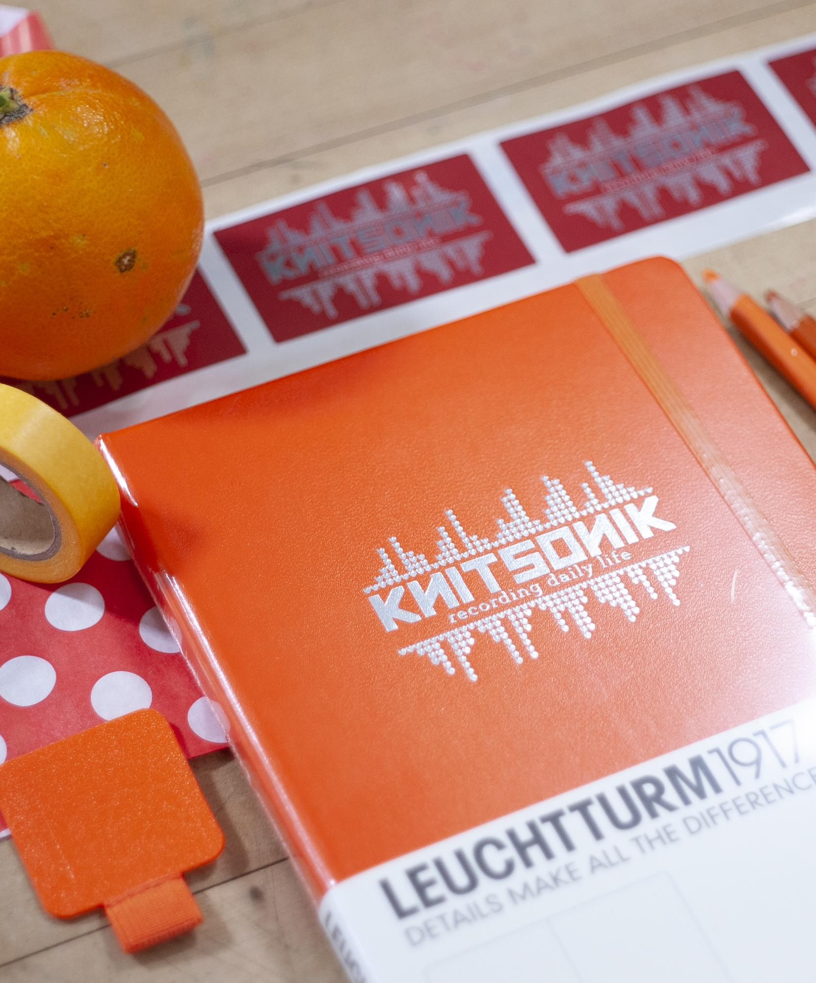 Orange Leuchtturm1917 pictured with orange items (including actual orange)