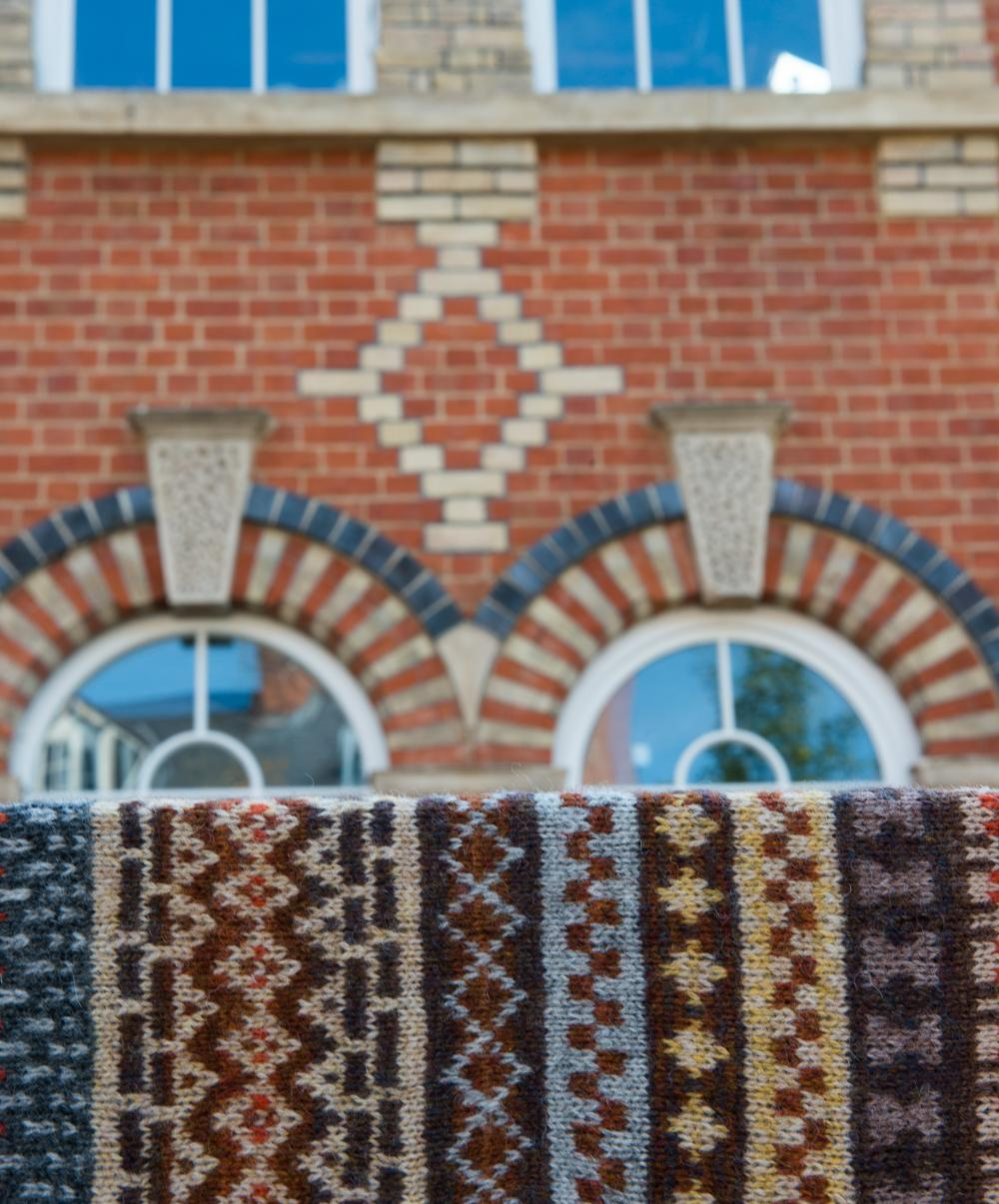 Polychromatic bricks of Reading presented along with stranded colourwork interpretation of polychromatic brick work