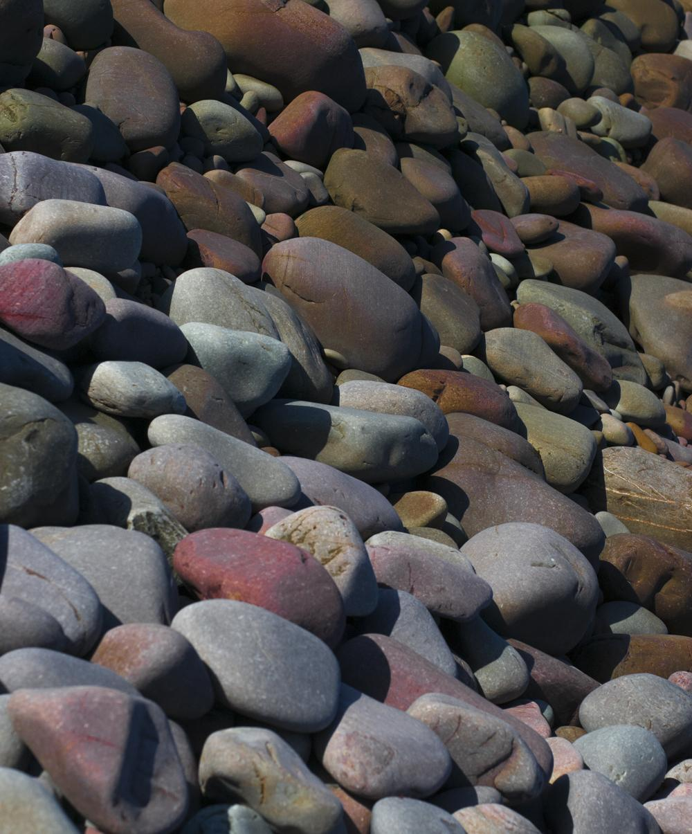 Porlock beach with its colourful stones, shown as relevant inspiration-source.