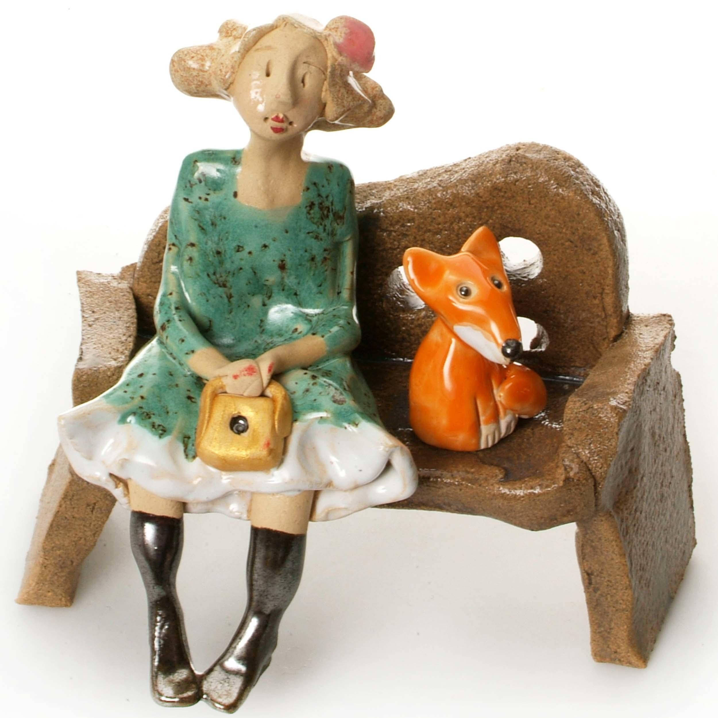 Ceramic Foxy Lady Figurine sitting on Bench with Fox