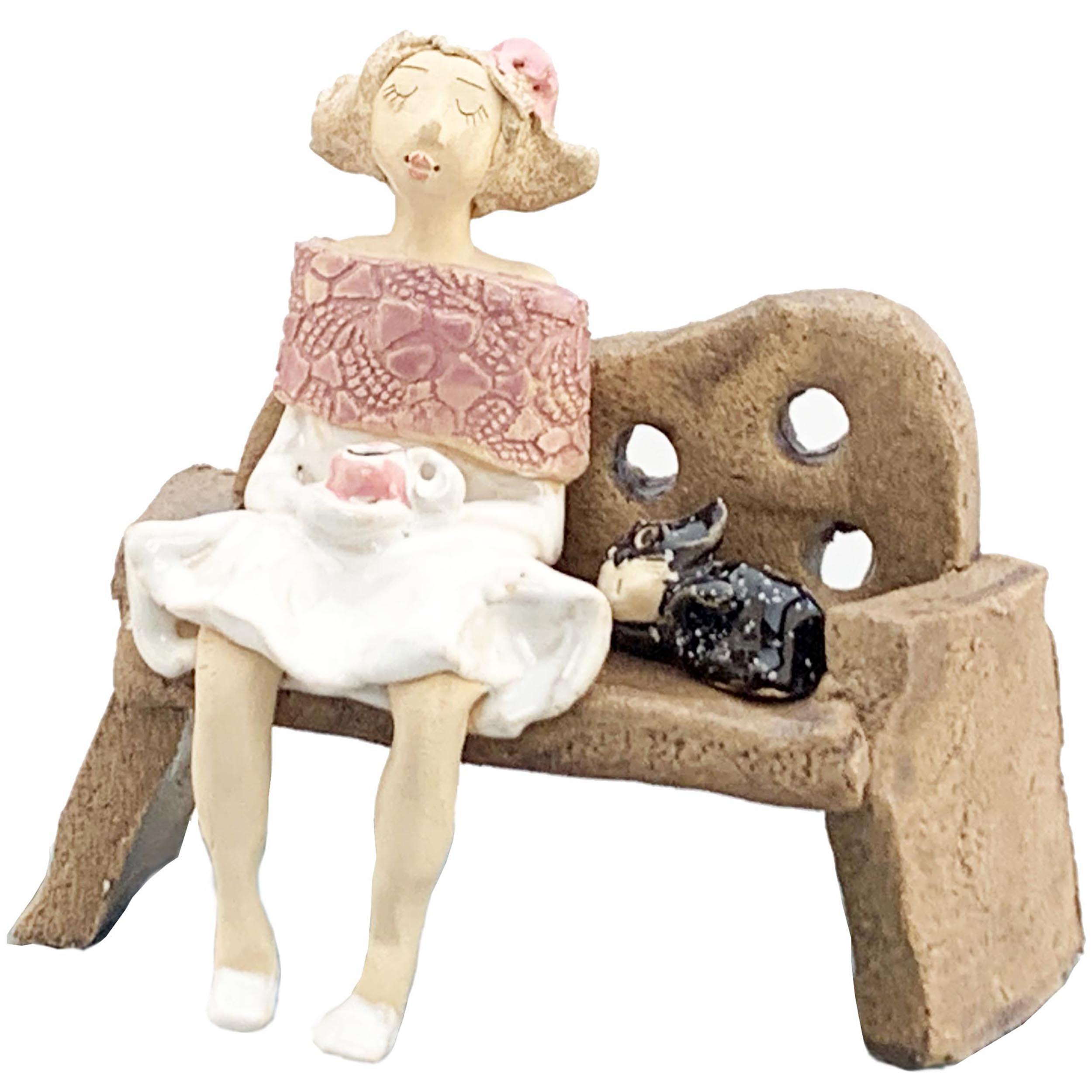 Quirky Ceramic Lady in Pink on a Bench with Black Cat