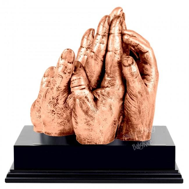 BabyRice Family Hand Cast with Metallic Copper Finish on Display Plinth