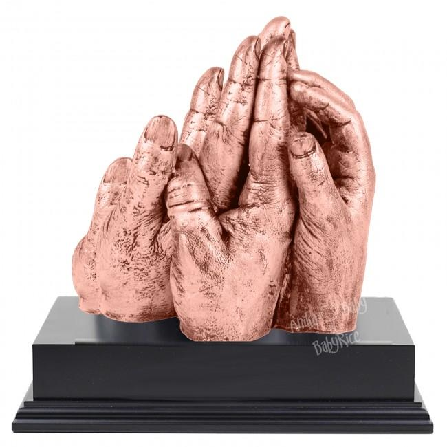BabyRice Family Hand Cast with Metallic Rose Gold Finish on Display Plinth