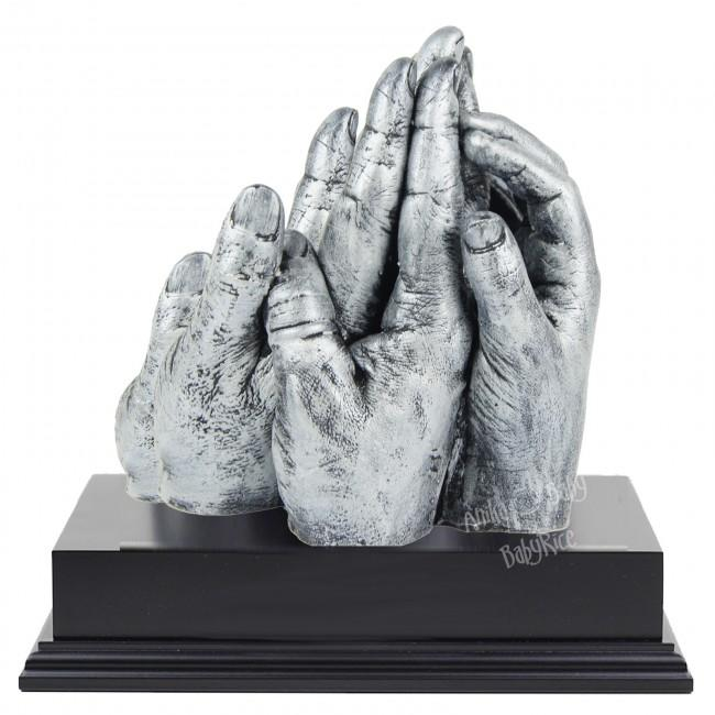 BabyRice Family Hand Cast in Metallic Silver on Display Plinth