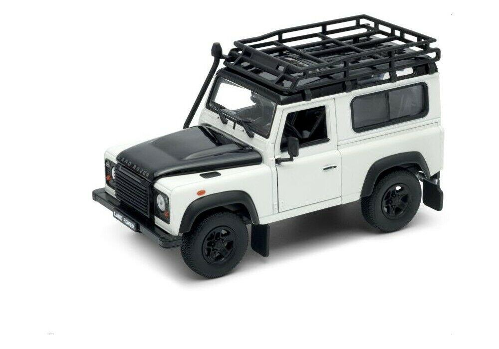 Land Rover Defender, white with roof rack and snorkel