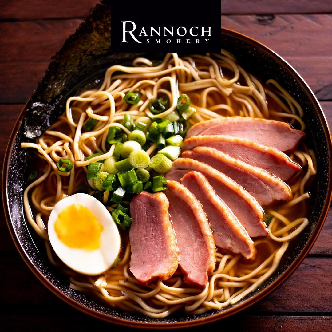Smoked duck served with noodles and a boiled egg