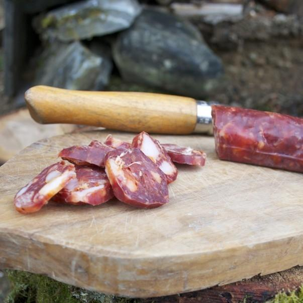 Slice venison and pork chorizo on a chopping board