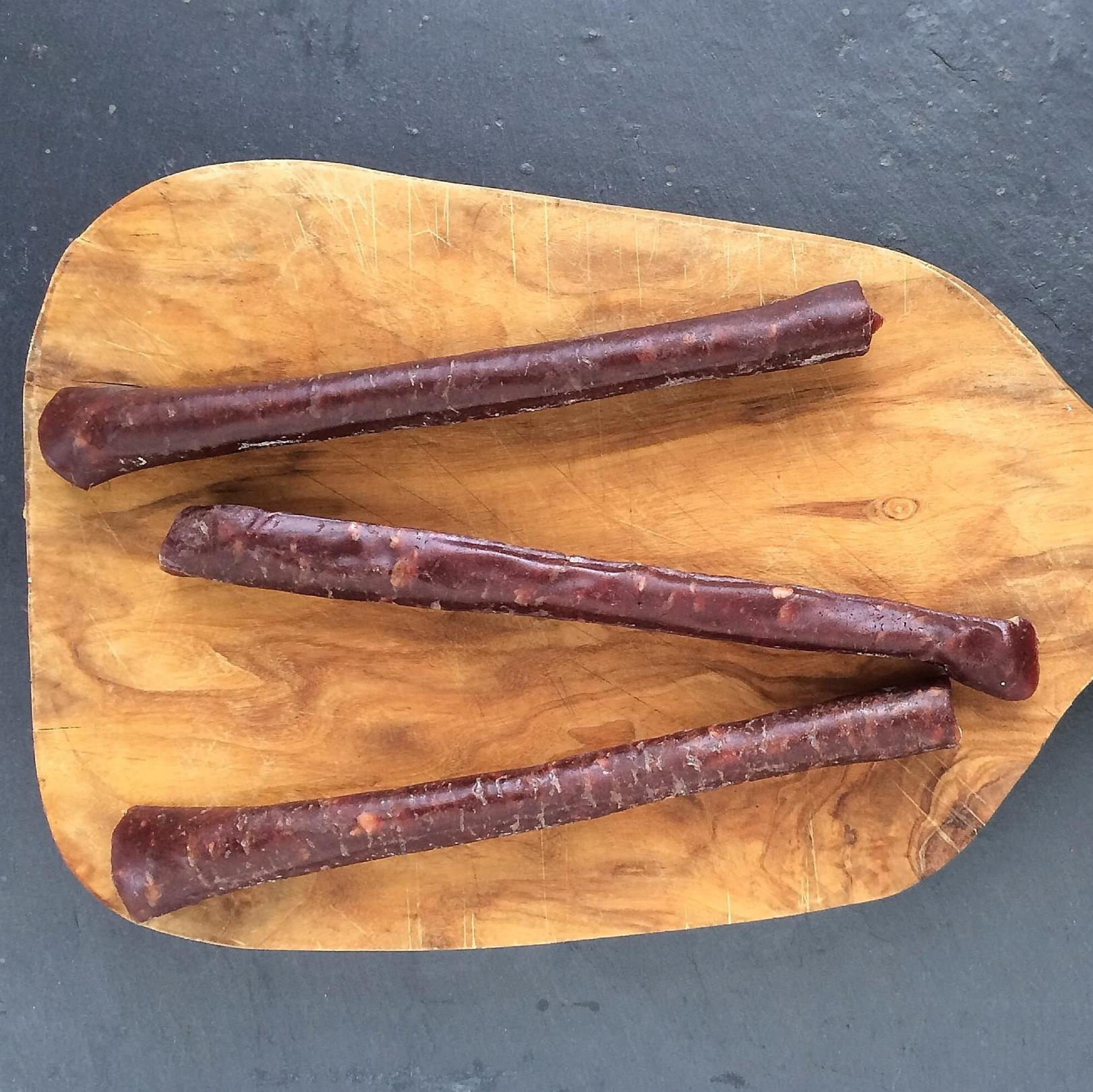 Venison pepperoni on a chopping board