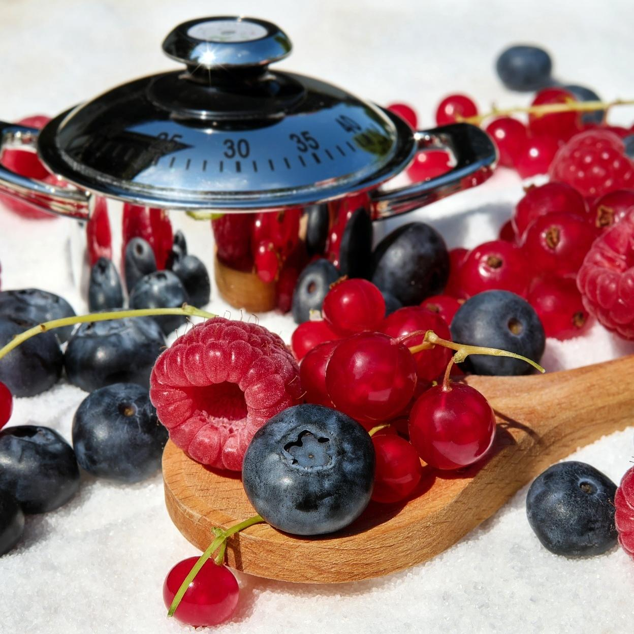 A display of a jam pan with berries