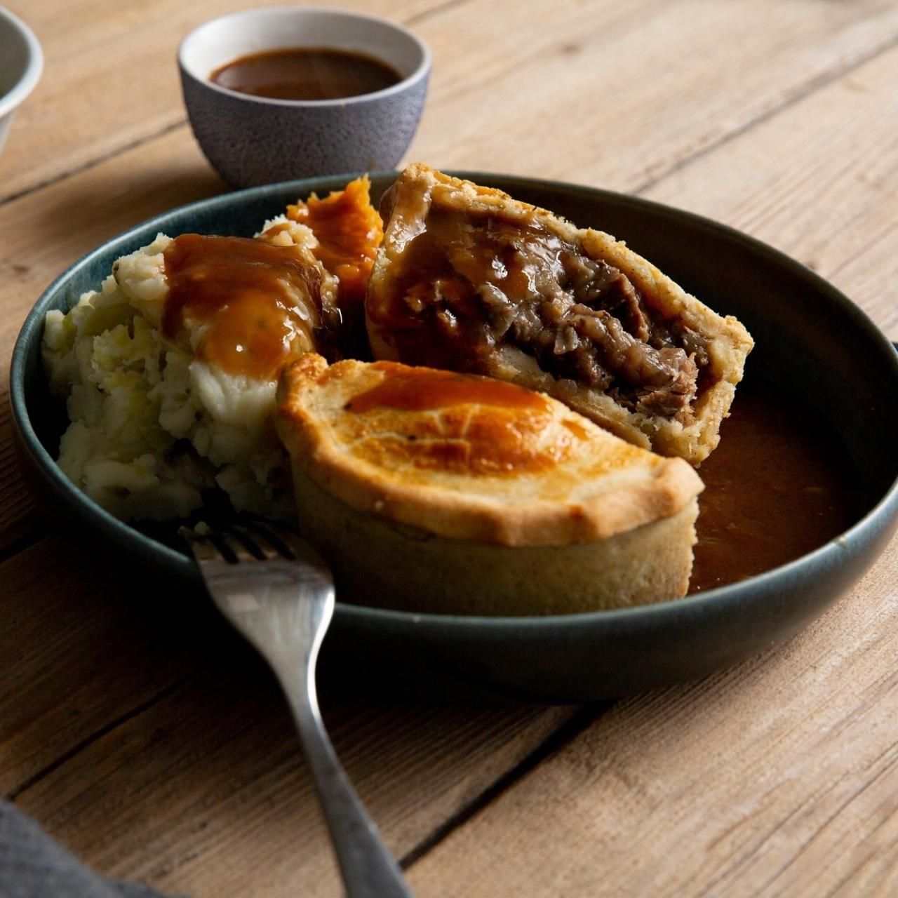 Beef and ale pie cut in half