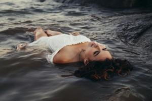 Yoga lady floating in water