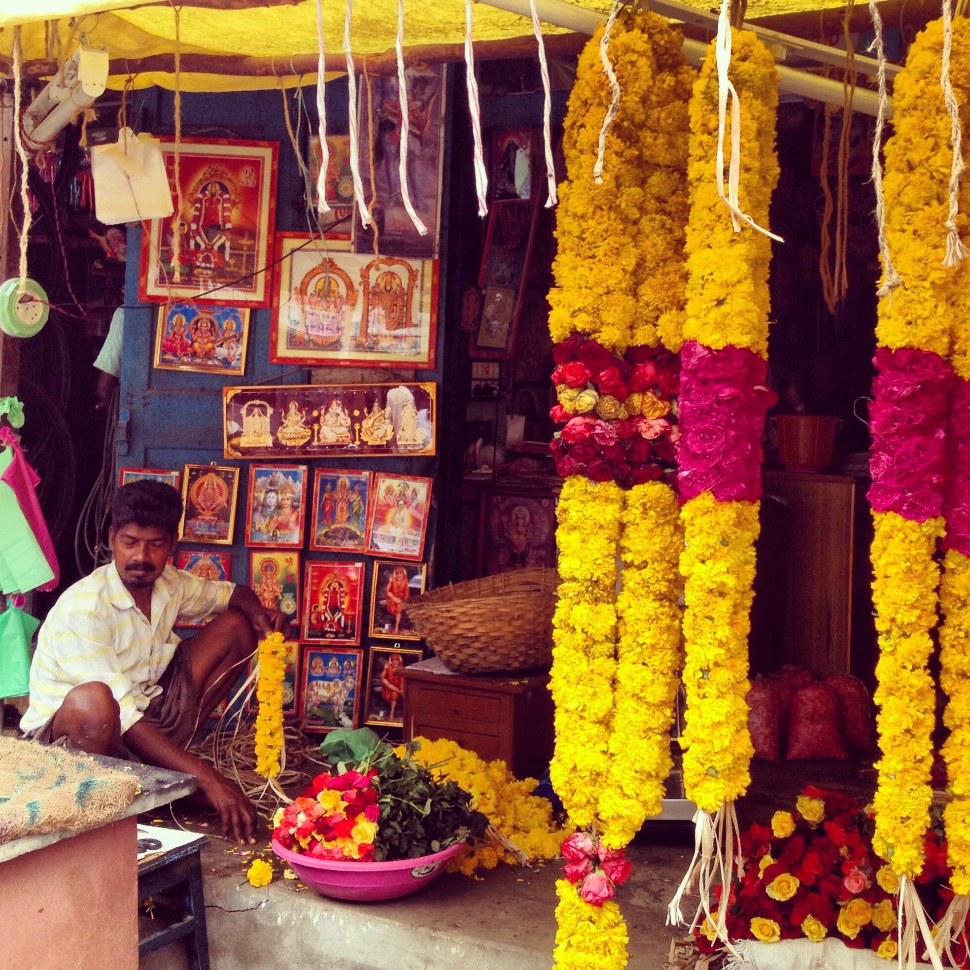 Yoga United holidays India Flower seller