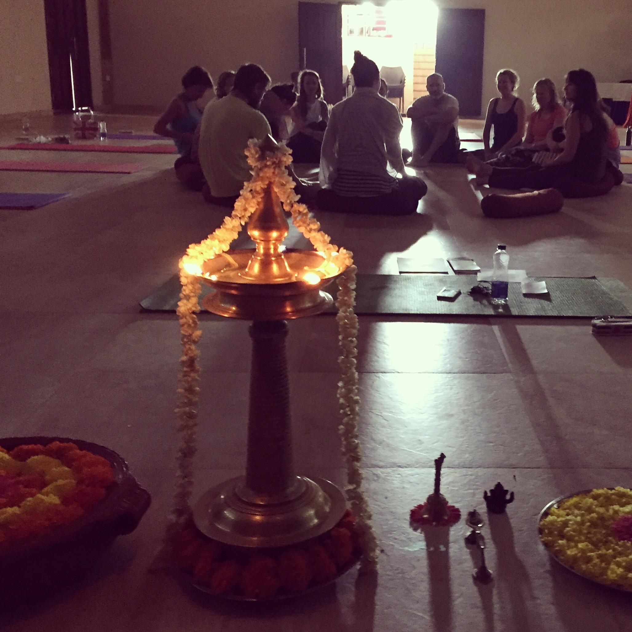 Yoga United holiday india retreat group session transformation circle oil lamp